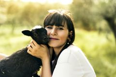 Beautiflul caucasian white woman with a goatling. royalty free stock image
