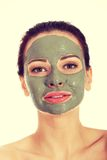 Beautifu有面部面具的toplessl妇女 免版税库存照片