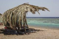 BEAUTIFU BEACH WITH CHAIRS AND UMBRELLA Stock Photos