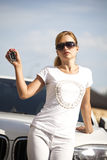 Beautifu blonde woman with car key in hand Stock Images