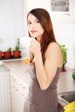 Beautifu caucasian woman in the kitchen Stock Image