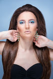 Beautifu girl with bright blue makeup and jewelery.  Royalty Free Stock Image