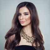 Beautifu Hair Woman. Girl with Long Brown Hair. And Golden Necklace Royalty Free Stock Images