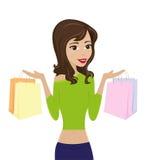 Beautifu kvinna med shoppingpåsar royaltyfri bild