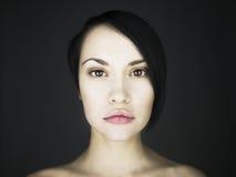 Beautifu lady. Portrait of beautiful young lady on a black background Stock Photo