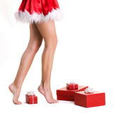 Beautifu llegs of christmas girl Stock Photography