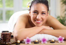 Beautifu smiling woman having a wellness back massage Royalty Free Stock Photography