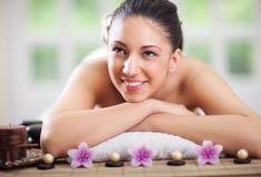 Beautifu smiling woman relaxing in spa center Stock Photos