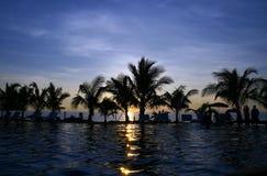 Beautifu sunset. Watching the sun fall beach Royalty Free Stock Images