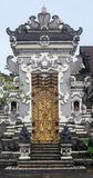 Beautifu temple wood and stone decorative gate with traditional asian patterns and sculptures. In Bali, Indonesia royalty free stock images