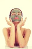 Beautifu toplessl woman with facial mask. Stock Photo