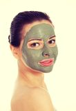 Beautifu toplessl woman with facial mask. Royalty Free Stock Photography