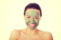 Beautifu toplessl woman with facial mask. Royalty Free Stock Images