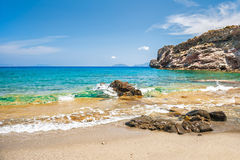 Beautifu tropical beach with clear turquoise water and rocks. Stock Photography