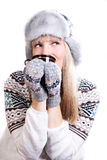 Beautifu woman in fur hat with a cup Royalty Free Stock Photo