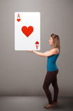 Beautifu woman holding a red heart ace Royalty Free Stock Photography