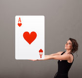 Beautifu woman holding a red heart ace Stock Photo
