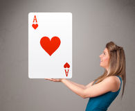 Beautifu woman holding a red heart ace Royalty Free Stock Images