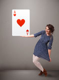 Beautifu woman holding a red heart ace Stock Images