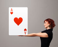 Beautifu woman holding a red heart ace Stock Image