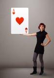 Beautifu woman holding a red heart ace Stock Photo