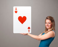 Beautifu woman holding a red heart ace Royalty Free Stock Photos