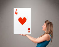 Beautifu woman holding a red heart ace Stock Photos