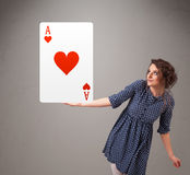 Beautifu woman holding a red heart ace Stock Photography
