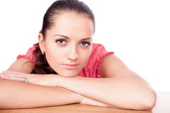 Beautifu young woman leaning on a table Stock Photography