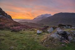 Beautifuk vibrant landscape image of mountains around Cregennen Lakes in Snowdonia on Winter sunrise morning. Stunning colorful landscape image of mountains royalty free stock photography
