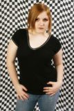 Beautiful 15 Year Old Teen. Teen girl against black and white checkered background Stock Photos