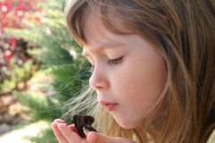 Beautiful. A beautiful young girl holding a moth stock photo