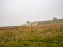 Beautiful abadoned house in the fog. In Iceland, Europe Royalty Free Stock Photos