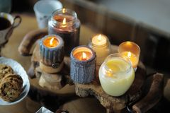 Beautiful ablaze candle. On the wooden table Royalty Free Stock Images