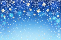 Beautiful abstract Christmas winter snowflakes bokeh background for decoration. Snow falling in blue sky with stars Royalty Free Stock Image
