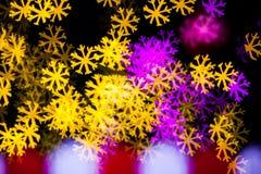 Abstract Yellow Purple lights snow flake bokeh background. Beautiful Abstract Yellow Purple lights bokeh background Royalty Free Stock Photo