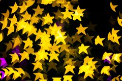 Abstract Yellow Purple lights Star bokeh background Royalty Free Stock Image