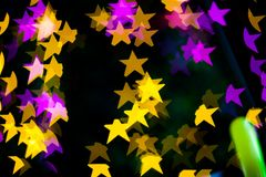 Abstract Yellow Purple lights Star bokeh background Royalty Free Stock Photography