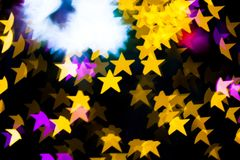 Abstract Yellow Purple lights Star bokeh background Royalty Free Stock Photos