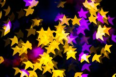 Abstract Yellow Purple lights Star bokeh background Royalty Free Stock Photo