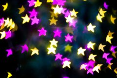 Abstract Yellow Purple lights Star bokeh background. Beautiful Abstract Yellow Purple lights bokeh background Royalty Free Stock Image