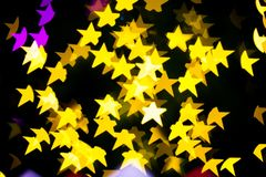 Abstract Yellow Purple lights Star bokeh background. Beautiful Abstract Yellow Purple lights bokeh background Royalty Free Stock Photos