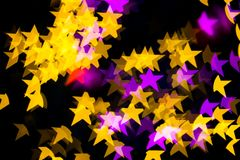 Abstract Yellow Purple lights Star bokeh background. Beautiful Abstract Yellow Purple lights bokeh background Stock Photography