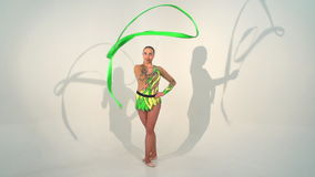 Beautiful acrobat dancing with a sash in slow motion stock video