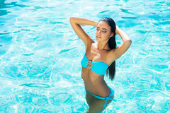 Beautiful, active and sporty girl in a swimming pool Stock Images