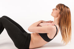 Beautiful active woman doing situps Stock Photos