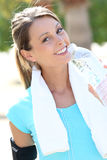 Beautiful active woman drinking water after jogging Stock Images