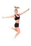 Beautiful active woman in a fitness wear jumping isolated over white background Royalty Free Stock Image