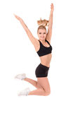 Beautiful active woman in a fitness wear jumping isolated over white background Royalty Free Stock Photos