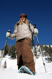 Beautiful active woman with snowshoes. A beautiful active woman ready to hike in the mountains with snowshoes Royalty Free Stock Images